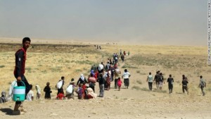 MOSUL, IRAQ - AUGUST 9: Thousands of Yezidis trapped in the Sinjar mountains as they tried to escape from Islamic State (IS) forces, are rescued by Kurdish Peshmerga forces and People???s Protection Unit (YPG) in Mosul, Iraq on August 09, 2014. (Photo by Emrah Yorulmaz/Anadolu Agency/Getty Images)