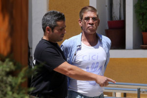 Egyptian Seif al-Din Mohamed Mostafa (R), who hijacked an EgyptAir passenger plane, is transferred by Cypriot police to a court in Nicosia, Cyprus April 22, 2016. REUTERS/Yiannis Kourtoglou
